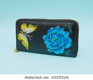 Woman wallet isolated on the blue background