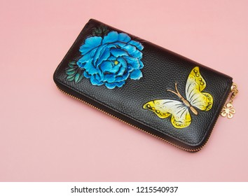 Woman wallet isolated on the pink background