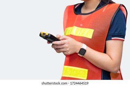 Woman warehouse worker using smartphone on white background