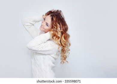 Woman in warm sweater, portrait on  white background, place for your text