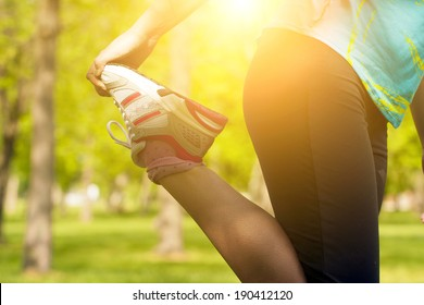 Woman warming up before running