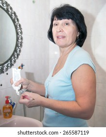 woman washes in   bath in   morning.