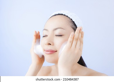 The woman washing her face