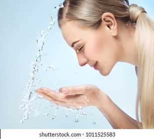 Woman is washing her face, fresh morning skin look, removing makeup, using anti acne or anti aging agent, pampering and beauty care concept