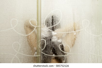 Woman washing her hair in the shower, hair and fashion