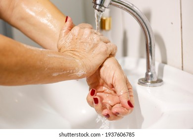 Woman washing her hands against virus covid19
