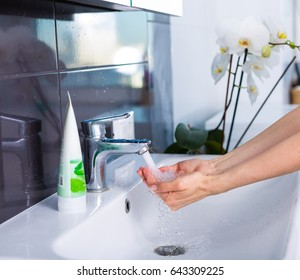 Woman washing up in the morning. Morning routine