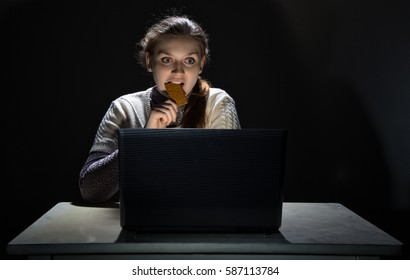 Woman watching movie and eating snack