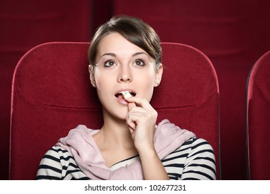 Woman watching a movie with enthusiasm