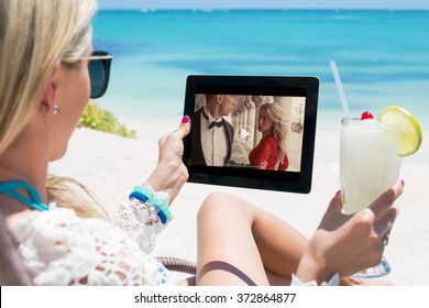 Woman watching movie on tablet computer