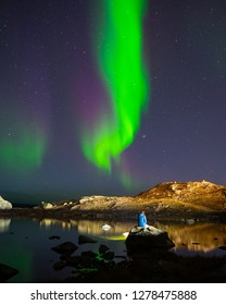 Woman watching the Northern Lights