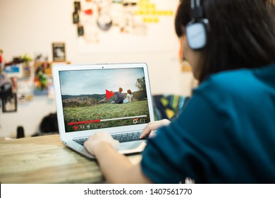 Woman Watching online video movie in living room