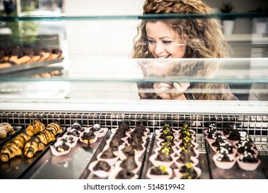 Woman watching pastries from a window