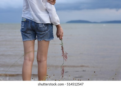 woman is watching the rain in the sea