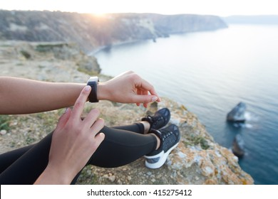 Woman watching training results on fitness tracker