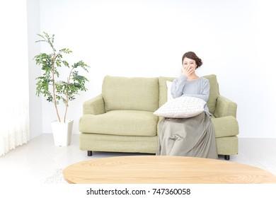woman watching TV at home