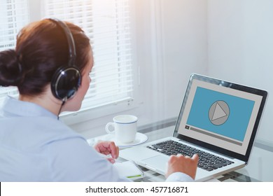 woman watching video tutorial on computer, business education online, multimedia