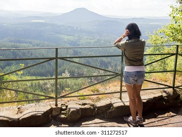 woman watching view of the valley, Czech republic