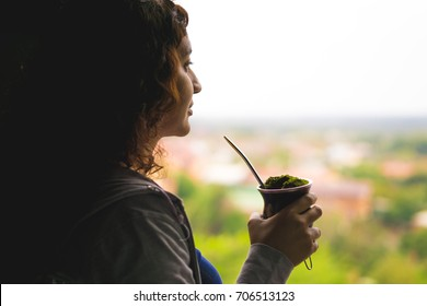 Woman watching the window with her Chimarrão - Rio Grande do Sul - South of Brazil.