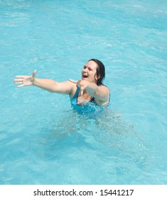 woman in the water merrily extend hands