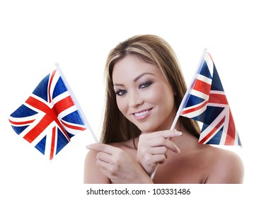woman waving a british flag about in the air