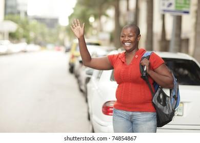 Woman waving on the street