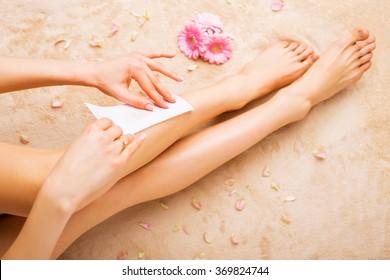 Woman waxing legs