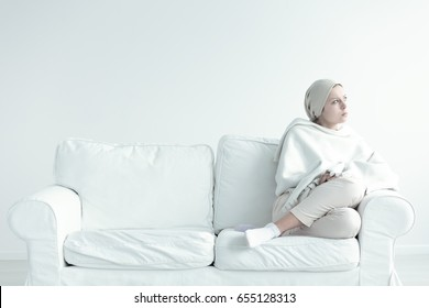 Woman weak and in pain after chemotherapy