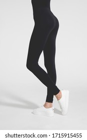Woman wear black blank leggings mockup, isolated, clipping path. Women in clear leggins template. Cloth pants design presentation. Sport pantaloons stretch tights model wearing. Slim legs in apparel.