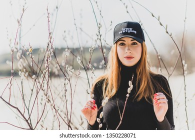 Woman wear black turtleneck, jeans and baseball cap, girl in sand desert. Fashionable casual style, fashion and clothes concept of modern look