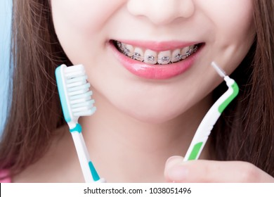 woman wear brace and take different brush