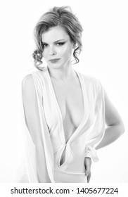 Woman wear dress with deep decollete. Girl curly hairstyle wear dress with decollete white background. Seductive decollete concept. Lady attractive sexy model. Attractive decollete with breasts.