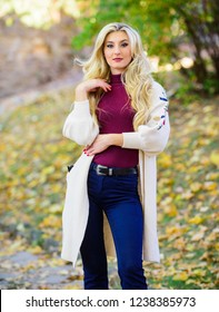 Woman wear long knitted cardigan while walk in park. Fall fashion cozy cardigan. Feel so warm and comfortable. Autumn fashionable cardigan. Girl stylish outfit with soft wool or cashmere cardigan.