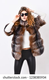 Woman wear sunglasses and hairstyle posing mink or sable fur coat. Fur fashion concept. Winter elite luxury clothes. Female brown fur coat. Fur store model enjoy warm in soft fluffy coat with collar.