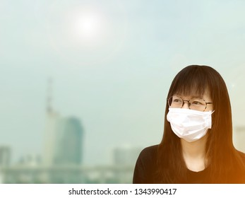 Woman wear white face mask because of air pollution in the city.Protect body from global warming.Girl wear mask from dust in the town.Woman worry about contamination open air.