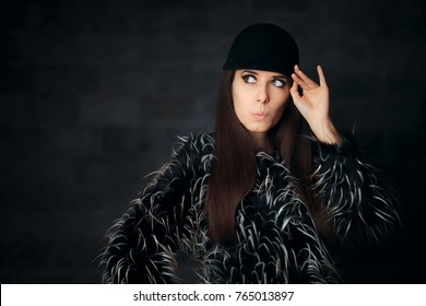 Woman Wearing Beautiful Winter Fur Coat and Fashionable Hat - Fashionista girl wearing riding style wool hat and faux fur jacket
