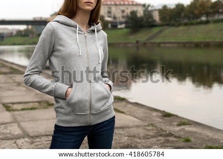 500ea379f79 Woman wearing blank grey hoodie, in the city street background near the  river