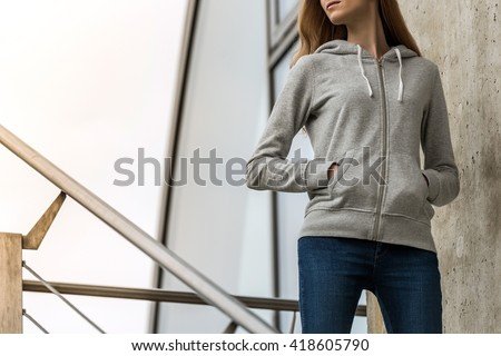 dd93474e1cc Woman wearing blank grey hoodie, in the city street background