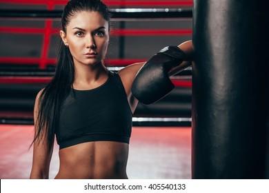 woman wearing boxing gloves near punching bag