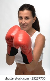 Woman wearing boxing gloves on guard