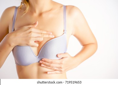 Woman Wearing A Bra Checking Her Breast, Breast Self-Exam (BSE), How do I check breast concept, Breast Cancer Awareness