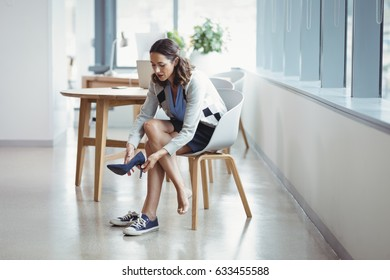 Woman wearing canvas shoes in office
