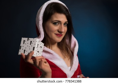 woman wearing a christmas costume and holding a box