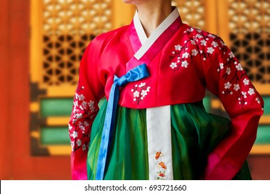 The woman wearing colorful Hanbok, Korean traditional dress in the Deoksugung Palace.