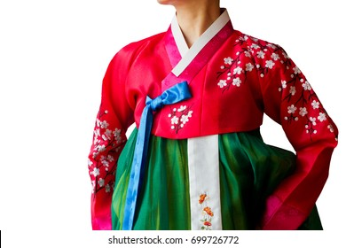 The woman wearing colorful Hanbok, Korean traditional dress isolated on the white background.