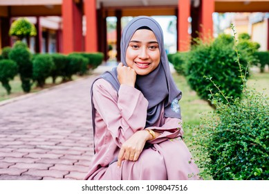 Woman wearing conservative Hijab fashion posing to a camera during portraiture session. The female wearing religious muslim outfit represents individualism  feminism and ethnic and racial acceptance.