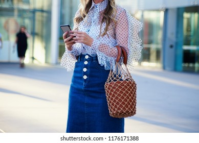 Woman Wearing Denim Skirt and Netted Bag, Casual Wear, Midsection