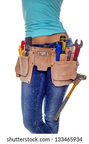 A woman wearing a DIY tool belt full of a variety of useful tools on a white background. DIY woman.