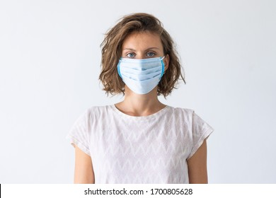 Woman wearing face medical mask. Flu epidemic, dust allergy, protection against virus. Covid-19, coronavirus pandemic