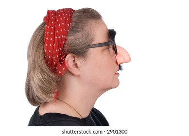 Woman wearing fake nose and glasses with mustashe and eyebrows over a white background